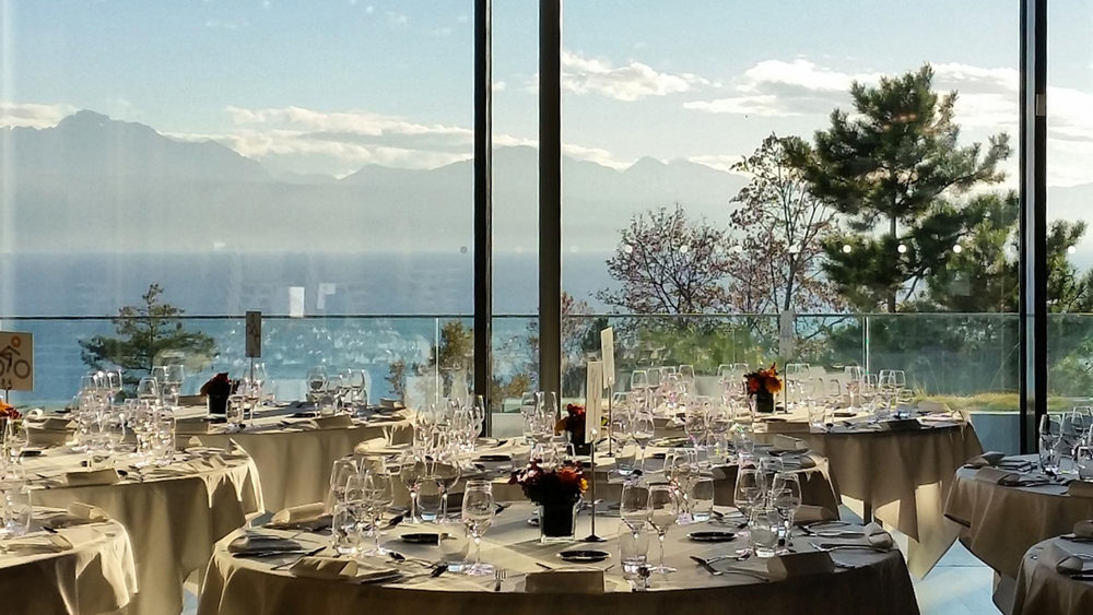 The stunning veranda setting of The Olympic Museum Café looking out on Lake Geneva (or tothe north of Geneva, as  Lac Leman ). This stock photo does not do justice to the actual setting.