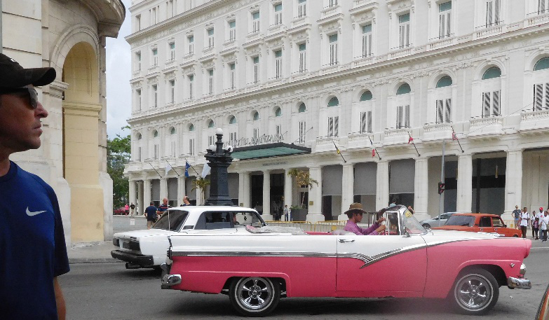 Colorful vintage cars in the streets of Havana (Photo by Gia Mendoza)