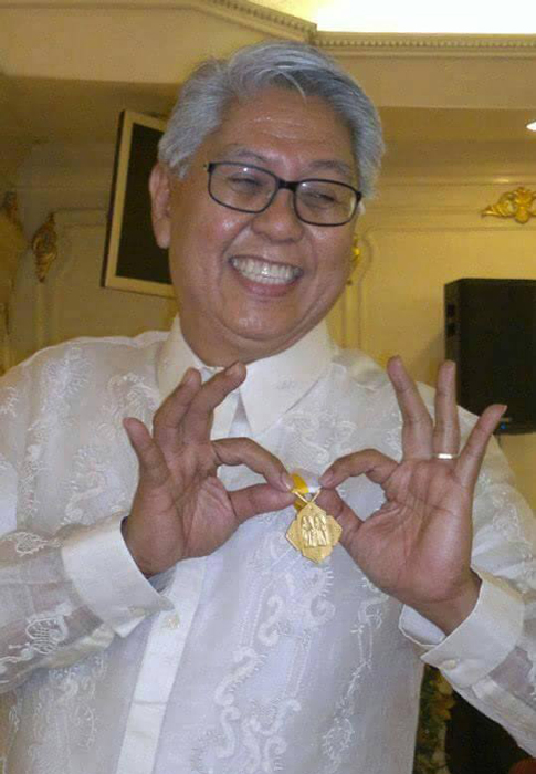 Proud recipient of the highest medal 2013 Papal Award for his contributions to the church. ((Photo by Barbara Ann Cayabyab)