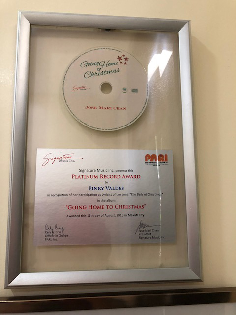 "Platinum award for ""Going Home to Christmas"" with Jose Mari Chan."