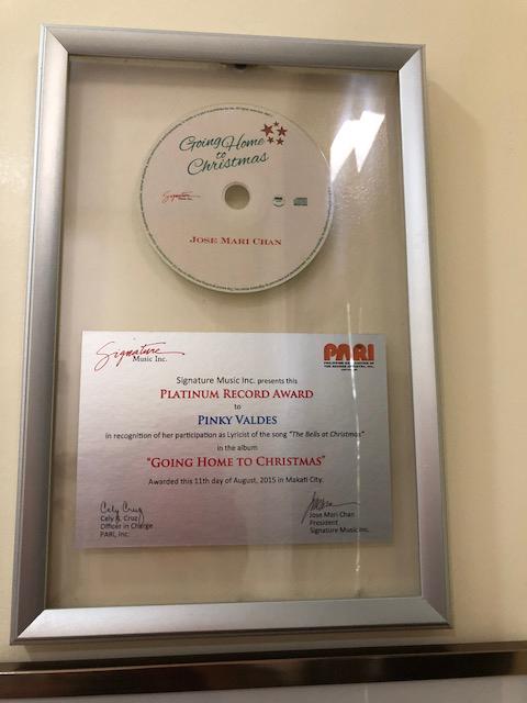 "Platinum award for ""Going Home to Christmas"" with Jose Mari Chan."