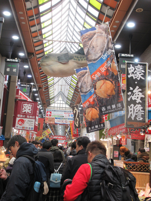 Shoppers pack Kuromon Market in Osaka everyday for great food and exciting products. (Photo by Bella Bonner)
