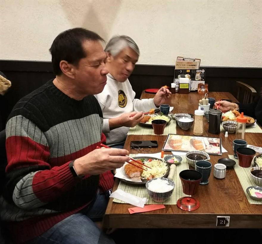 Chef Sandy Daza and Cyrus Fagar enjoy their pork tonkatsu. (Photo by Rho Clemente)