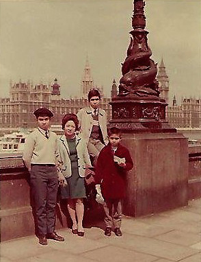 Still in  olde  London  towne , in front of the buildings of Parliament (From left: David, Mom, me on the ledge, Philip. Photo courtesy of the author.)