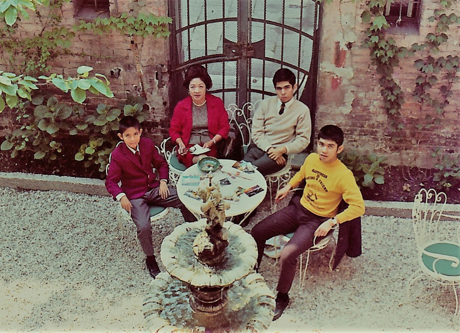 In the garden of the London hotel. (Left to right: Philip; Mom; the author (the sullen one), and David. Dad took this picture from the room. May 20, 1968. (Photo courtesy of the author).