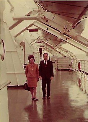 My dear parents, Lydia and Pete Garcia, on the deck of the  SS United States , near our assigned lifeboat, May 1968. (Photo courtesy of the author.)