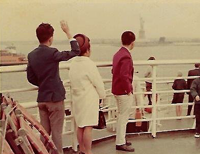 """ Hello, Lady Liberty, here we come! "" Entering New York Harbor, (from left),  moi , Mom, and David. Quite coincidentally, I was wearing a blue blazer, mom was in white, and David in red – clearly visible if the photo hadn't faded. The tricolor ensemble wasn't preplanned at all. May 28, 1968 (Photo courtesy of the author)"