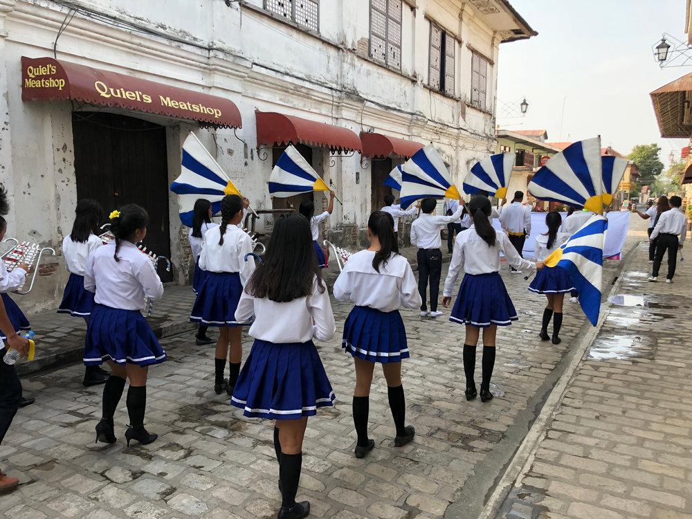 A morning parade on Calle Crisologo (Photo by Criselda Yabes)
