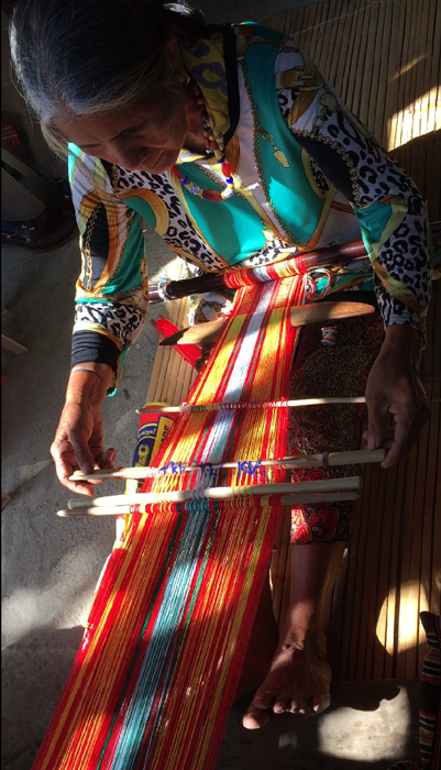 Apo Onang using with a backstrap loom. She learned weaving from her mother. The younger women no longer weave.