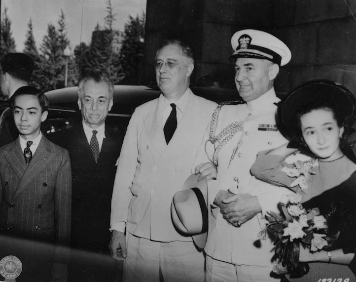 (From left to right) Manuel Quezon, Jr., Philippine President Manuel Quezon, U.S. President Franklin D. Roosevelt, Captain John McCrea, and Maria Aurora Quezon upon the arrival of President Quezon's party to Washington, D.C. May 13, 1942.  (Photo courtesy of the Franklin D. Roosevelt Presidential Library and Museum, Hyde Park, New York)