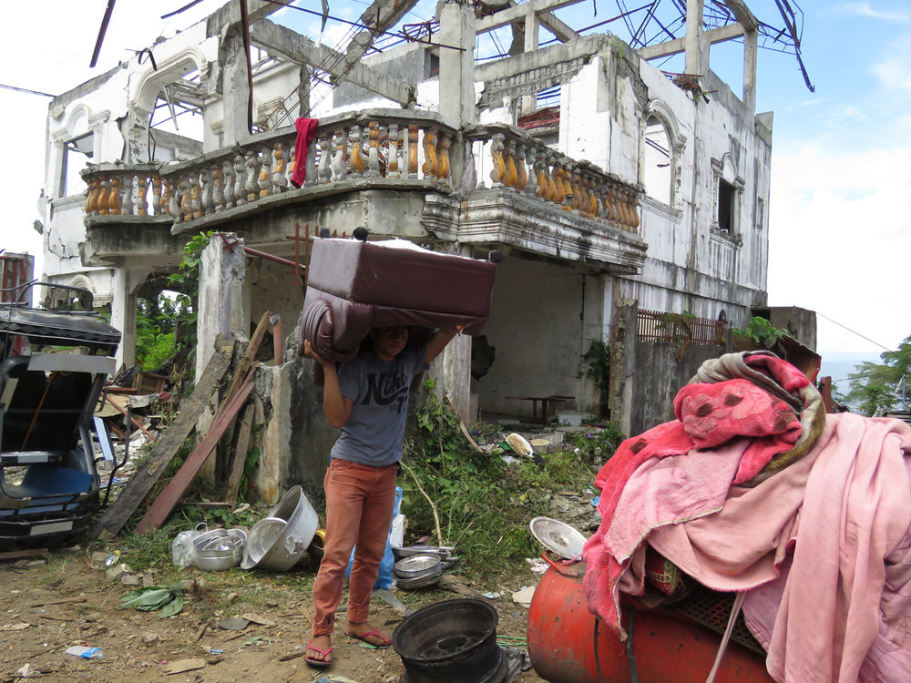 A resident retrieving what's left of home (Photo by Criselda Yabes)