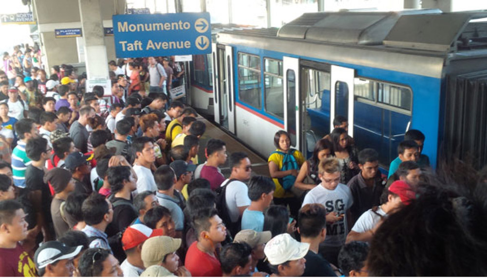 MRT crowd: There is always a thick crowd of commuters at the rails, and altercations between impatient passengers and security guards tasked to inspect bags are not unheard of. (Source: INQUIRER.net)