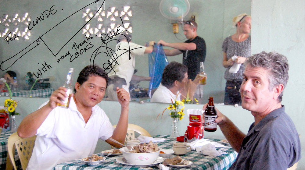 Cheering to the good times! The author and Anthony Bourdain at the goat shack in Angeles City, October 2008. (Photo courtesy of Claude Tayag)