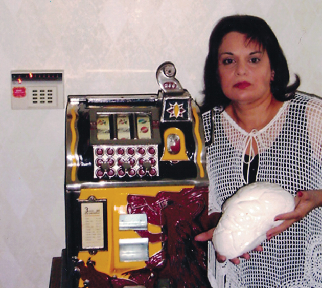 "Laura Lintner-Horn, so-called ""stepdaughter"" of one Victor Barbish, current ""owner"" of the Lao-Tzu Pearl, holds the non-nacreous pearl at Barbish's home in Colorado in 2004. The pearl is about 9.5 inches long and weighs 14 lbs (est). (Photo courtesy of Laura Lintner-Horn and  The Atlantic Magazine)"