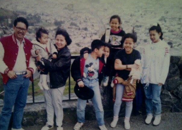 The Buenafe family and a cousin. Mayo is sitting on the ledge (Twin Peaks, San Francisco, California 1993).
