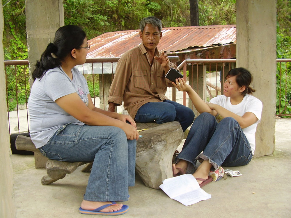 Mayo and friend from Kiangan, Ifugao interview a woodcarver from Hapao, Ifugao (2007).