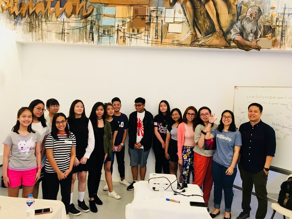 Teens group at summer workshop with ad executive-author Russell Molina