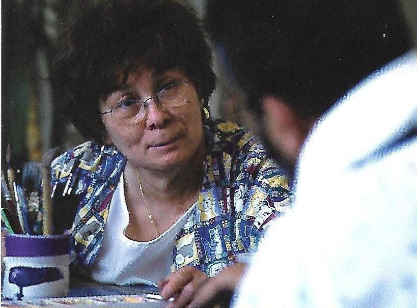 Corazon Pecson Pagnani confers with a patient. (Photo courtesy of Corazon Pecson Pagnani)
