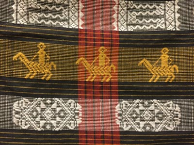 Detail of horse embroidery in Itneg textile