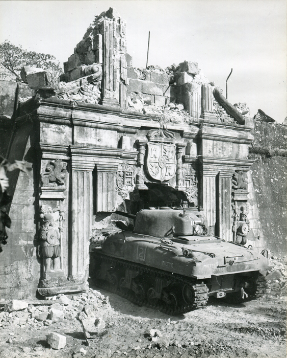 An American tank rumbles through the historic gate of Fort Santiago inside the Walled City on February 26, 1945. (National Archives)