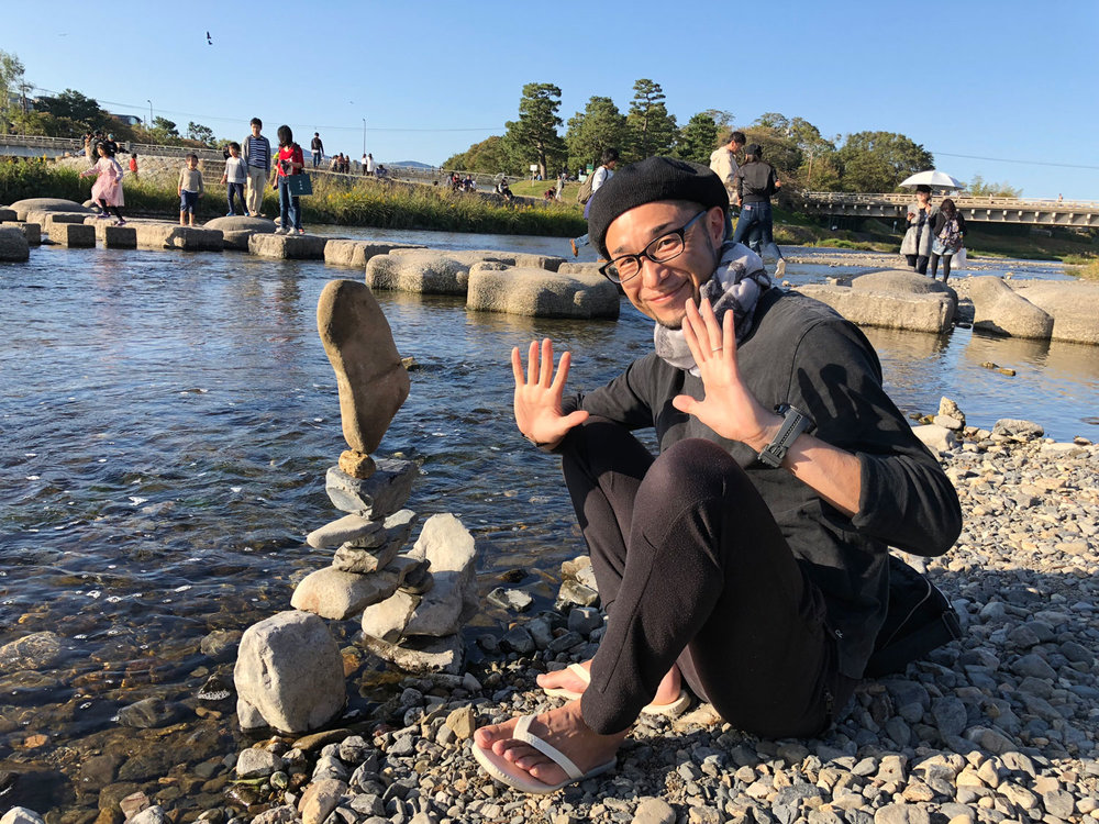 One sunny Sunday by delta of the Kamo river, Daisuko builds his castle of rocks. He calls himself a rock-balancing artist and he's been featured in the news. (Photo by Criselda Yabes)