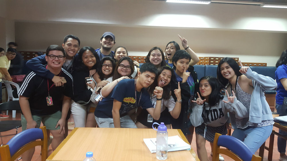 12 years later, December 2018, Maia (extreme right) celebrates with schoolmates after Ateneo wins the championship.