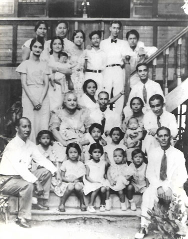 The clan of Felipe Tempongko and Leocadia L'heritier at Pulong Mayaman, Malate, in 1934. The family patriarch is shown in the center, third row, with his wife to his right. Surrounding him are his children, some of their spouses and the nine grandchildren who had been born by then.