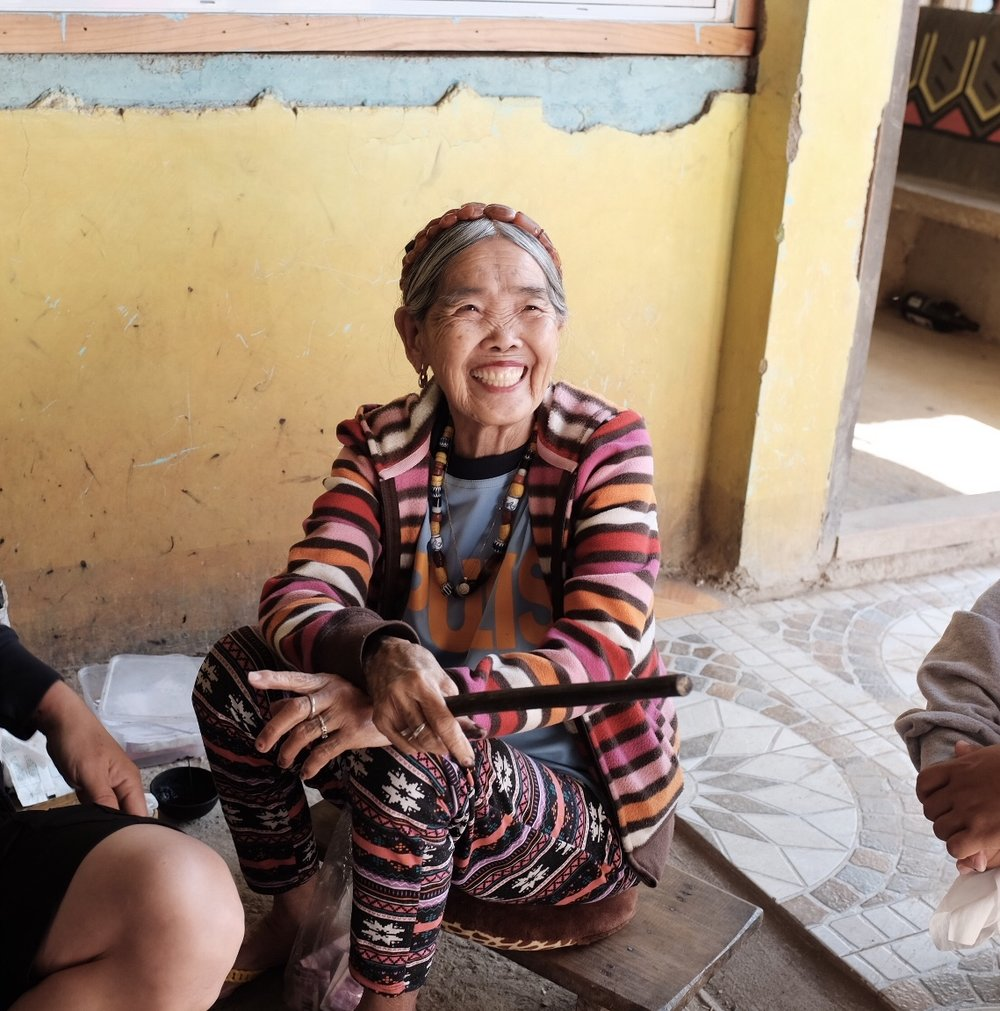 Whang Od breaks into a smile at the antics of her visitors. She celebrated her 102nd birthday on February 17, 2019 (Photo by Jensen Esteves and Maia Almendral Esteves).