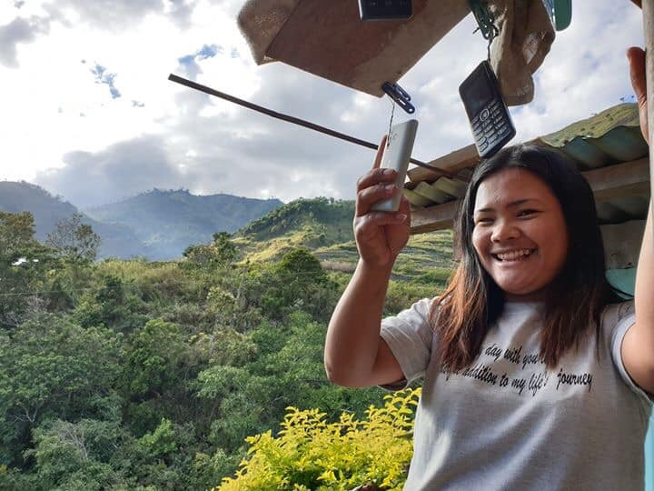 Our tour guide, Racquel, standing on the patio of her home in Buscalan. She and her family hang their cell phones to try to get a bit of reception (Photo by Bernard So-Kua)