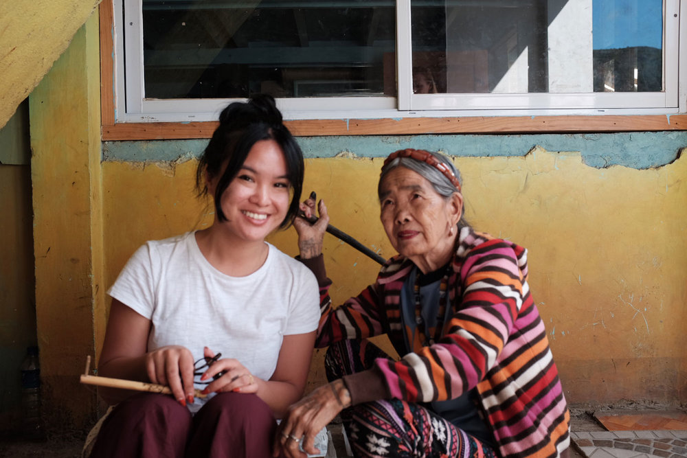 Whang Od before applying her signature tattoo on my back. Racquel acted as translator between us, explaining the second tattoo I planned to get from her grandniece. Whang Od asked for my input on design placement, but ultimately the decision was hers (Photo by Jensen Esteves).