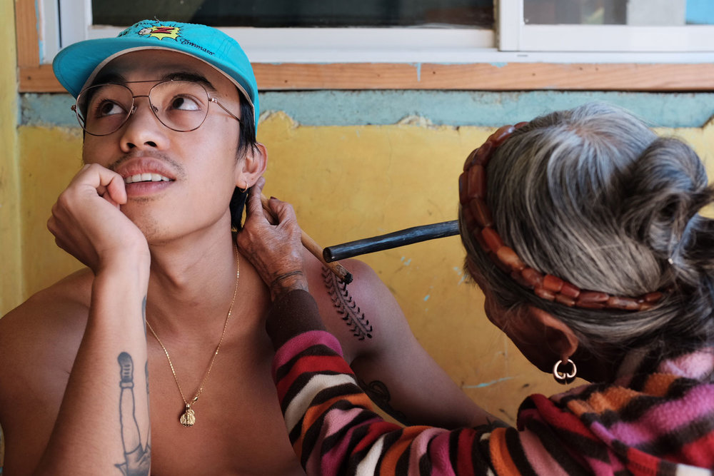 Jensen got the increasingly rare honor to be tattooed by Whang Od herself. She took two hours to complete a centipede design (Photo by Maia Almendral Esteves).