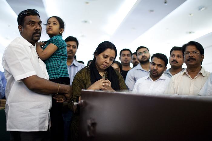 Dubai, June 27, 2012 – The parents of nine-year-old Bonie Joseph Jr, who  drowned in a pool in Bur Dubai, grieve at his funeral at Mar Thomas  Church in Dubai.