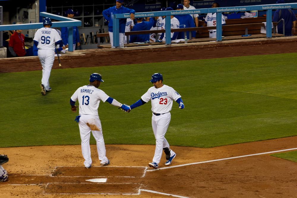 Adrian Gonzalez (23) and Hanley Ramirez (13) celebrating after Gonzalez hit a two-run home run.