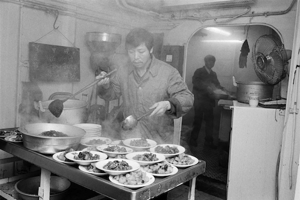 GB. England. Liverpool. Kitchen on Dade which is docked in Gladstone Dock. 1984. © Martin Parr
