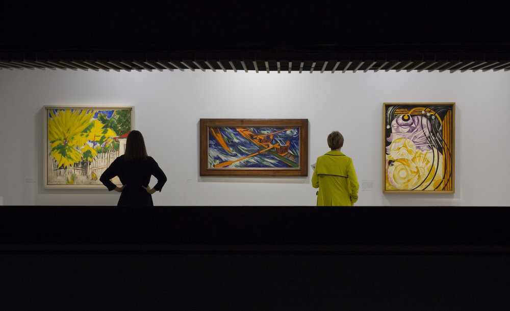 Modern Couples: Art, Intimacy and the Avant-garde Installation view featuring Mikhail Larionov, Paysage, 1912 Natalia Goncharova, Rowers, 1912 Natalia Goncharova, La lampe électrique, 1913 Barbican Art Gallery 10 October 2018 – 27 January 2019 © John Phillips / Getty Images