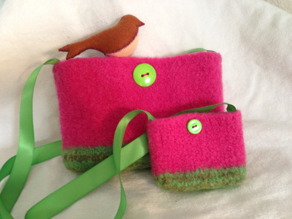 Matching felted purses for my niece and her American Girl doll.  Everything from stash except the pink yarn (and maybe the larger button, I can't quite remember...).  Pattern made up as I went along (very simple).  The buttons are purely for show - there is one on each side and they hide the stitches that hold on a snap to keep the bags closed.  The adorable simple bird is sewn from wool felt (I always get mine from A Child's Dream Come True) using a free pattern from Alanna George at The Craft Nest.  The bird went to my grandmother, not my niece.  :)