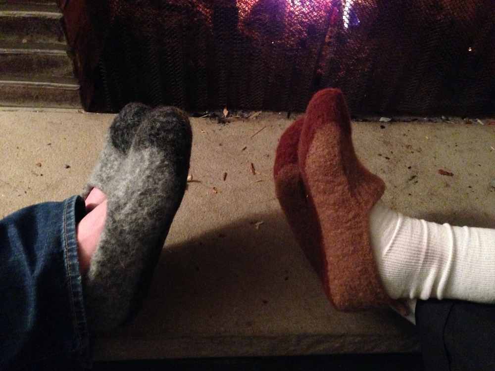 Finally, two pairs of slippers on their first fireside relaxation run.  These are Duffers Revisited by Mindie Tallack, the original pattern in grey for (another) brother-in-law and with a bit of a tongue added (with inspiration from some other Ravelers' projects) in the browns for my father-in-law.