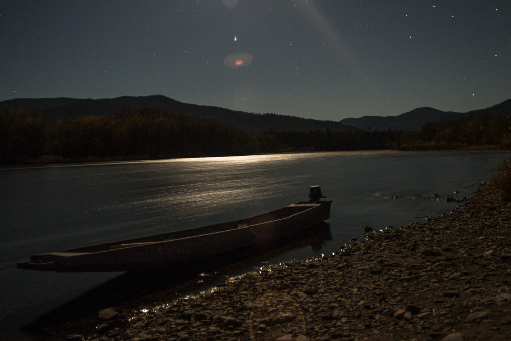 An official park patrol boat, tethered to the shore while the moon rises over the Ussuri.