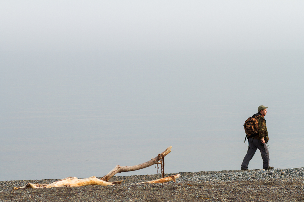 Dmitry guides us along the coast; low clouds create a nearly invisible horizon.