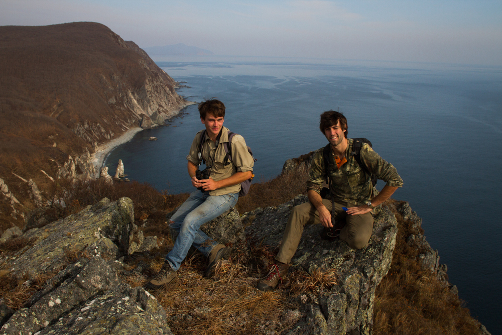 "Dave and I on top of ""The Tower"", one of the Reserve's highlight hiking destinations. The Education and Tourism Departments are working together to attract more tourist to the Reserve. Annual federal funding that enters the park is 53 million Rubles (1.62 million USD) and the salary for employees alone is 33 million Rubles ( 1 million USD). Without other sources of income the park struggles to fund important conservation efforts."