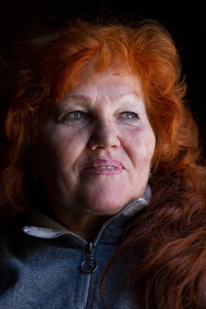 Taisia Palkina. The women with red hair.