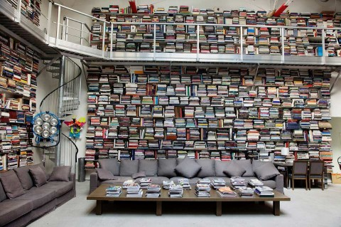 One book at a time.   (via  swissmiss | Stunning Bookshelf (shot by Selby) )