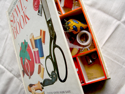 Amazing storage solution! I'm always looking for ways to hide all the bits and pieces I have lying around. (pat rack much? yes.) (via How to make a sewing box from a book)