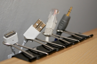 Must…do…this.   (via  Use binder clips to secure cords | How About Orange )