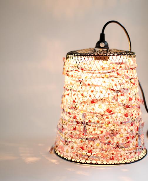 (via poppytalk: DIY: Wire Waste Basket Turned Pendant Light)
