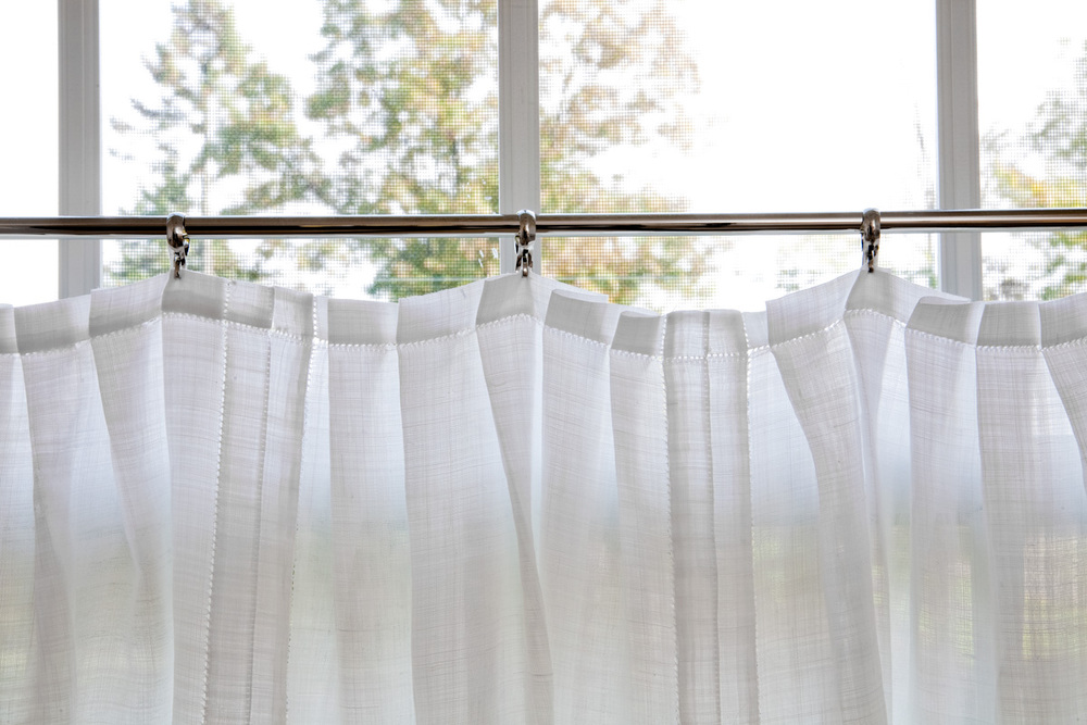 Six napkins sewn into one cafe curtain, pleats on header create more opacity for privacy