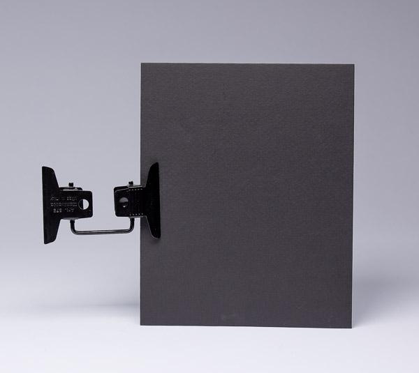 The Multi-Clip and black cardboard