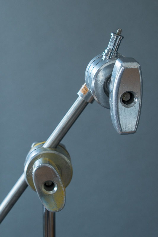 Stud inserted into the grip head to hold a small lamp head.