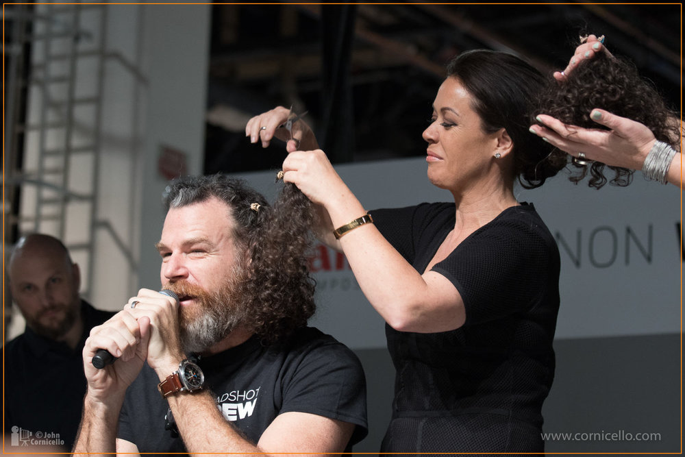 Sue Bryce shaves Peter Hurley's head at WPPI