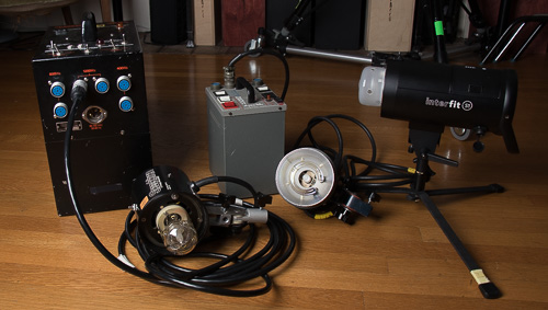 Speedotron 2401A and Dyna-lite D804ii pack & head systems, along side an Interfit S1 (self contained, including battery, no A/C power required, but optional).